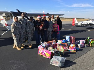 Soldiers and some of the pilots with their gifts